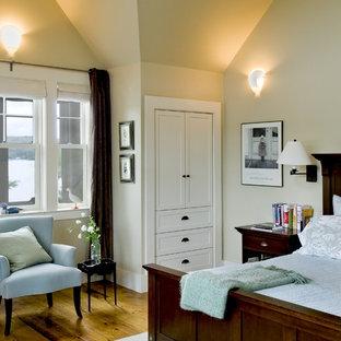 Inspiration for a rustic medium tone wood floor bedroom remodel in Burlington with beige walls