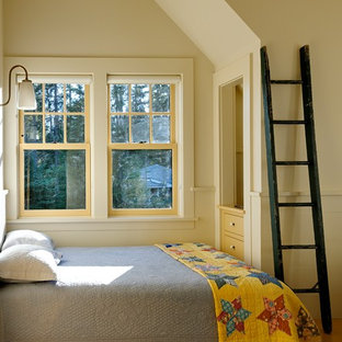 Example of a mountain style guest bedroom design in Burlington with beige walls and no fireplace