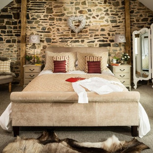 Large rustic guest bedroom in Other with white walls, carpet and grey floors.