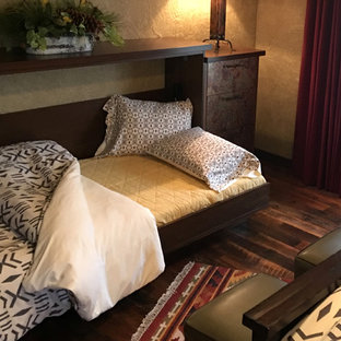 Inspiration for a mid-sized rustic bedroom remodel in Other