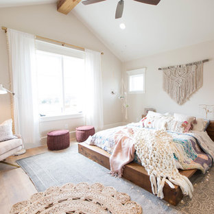 Mid-sized danish light wood floor bedroom photo in Dallas with white walls