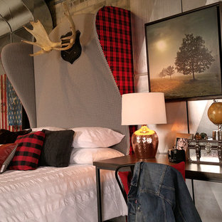 Design ideas for a large industrial loft-style bedroom in Toronto.