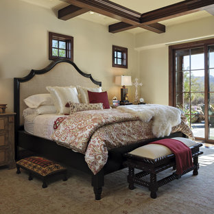 Example of a southwest master bedroom design in Phoenix with beige walls