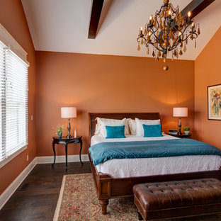 Mid-sized arts and crafts master bedroom in Indianapolis with orange walls, dark hardwood floors and brown floor.