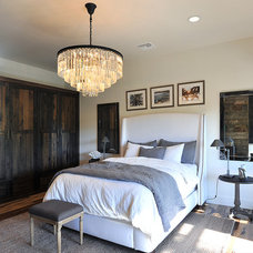Rustic Bedroom by JRP Design & Remodel
