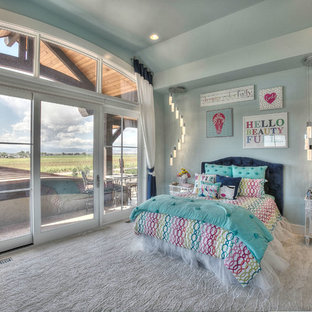 Inspiration for a mid-sized rustic guest carpeted bedroom remodel in Denver with blue walls and no fireplace