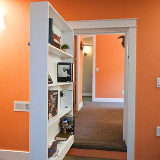 Mid-sized eclectic guest carpeted bedroom photo in Other with orange walls