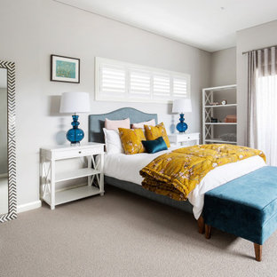 Large transitional master bedroom in Sydney with grey walls, carpet and grey floor.