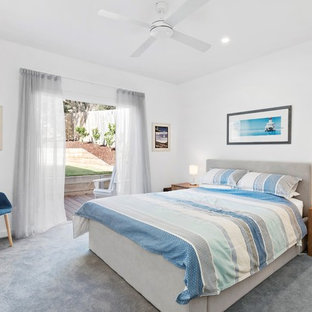 Inspiration for a beach style guest bedroom in Melbourne with white walls, carpet and grey floor.