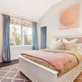 Bedroom - transitional guest dark wood floor and brown floor bedroom idea in New York with beige walls