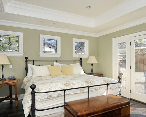 Example Of An Ornate Dark Wood Floor Bedroom Design In San Francisco With  Green Walls