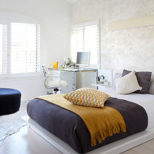 Medium sized contemporary guest bedroom in Orange County with multi-coloured walls, light hardwood flooring, no fireplace and grey floors.