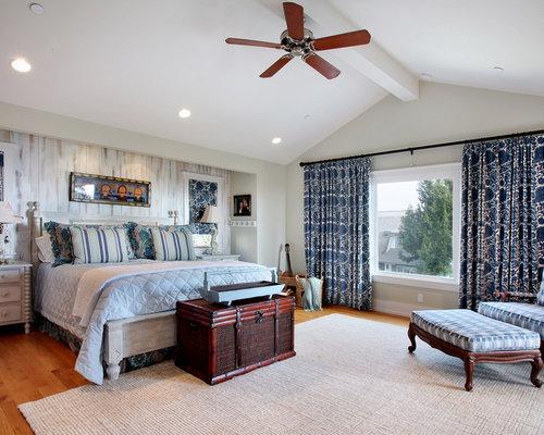 Coastal Medium Tone Wood Floor Bedroom Photo In Orange County With  Multicolored Walls