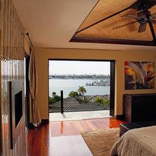 Tropical Bedroom by David Brandsen Construction Inc.
