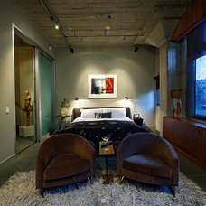 Industrial Bedroom by Contour Woodworks