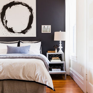 Inspiration for a traditional master bedroom in San Francisco with black walls and medium hardwood flooring.
