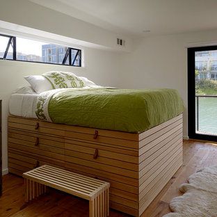 Inspiration for a modern medium tone wood floor bedroom remodel in San Francisco with white walls