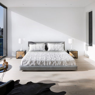 Inspiration for a contemporary light wood floor bedroom remodel in San Francisco with white walls