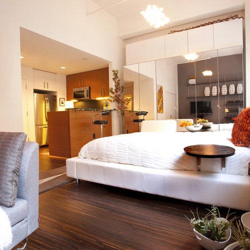 Minimalist Dark Wood Floor Bedroom Photo In San Francisco With Beige Walls