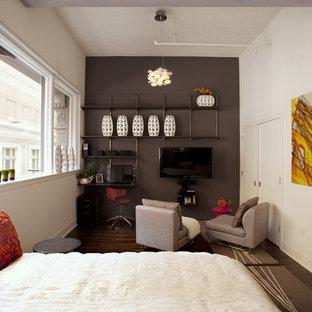 Immagine di una camera matrimoniale minimalista con pareti grigie