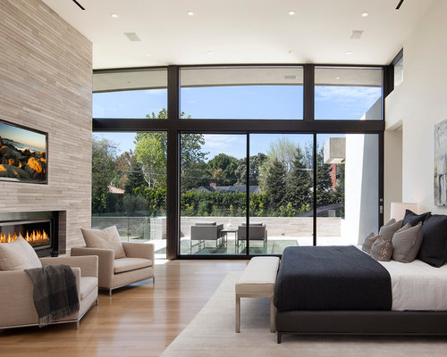Contemporary master light wood floor bedroom idea in Los Angeles with beige  walls, a ribbon