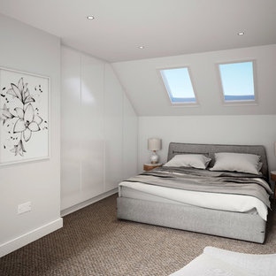 Contemporary guest bedroom in London with white walls, carpet and brown floors.