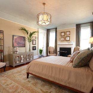 На фото: большие хозяйские спальни в стиле фьюжн с коричневыми стенами, темным паркетным полом, стандартным камином, фасадом камина из плитки и коричневым полом