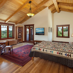 Bedroom - craftsman master medium tone wood floor bedroom idea in Santa Barbara with beige walls and no fireplace