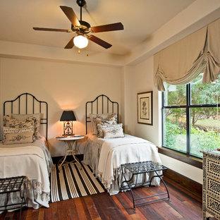 Bedroom - traditional guest dark wood floor bedroom idea in Austin with white walls