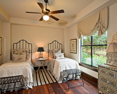 luggage rack for bedroom. Traditional guest dark wood floor bedroom idea in Austin with white walls Luggage Rack  Houzz