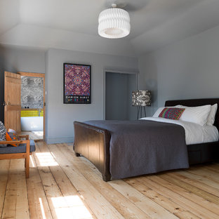 Medium sized country guest bedroom in Other with grey walls, light hardwood flooring and beige floors.