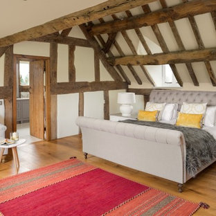 Photo of a medium sized rural bedroom in Cheshire with beige walls, medium hardwood flooring and beige floors.