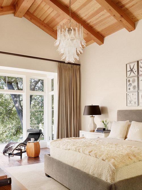 Bedroom   Contemporary Medium Tone Wood Floor Bedroom Idea In Austin With  Beige Walls