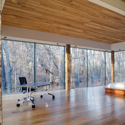 Minimalist medium tone wood floor bedroom photo in Cincinnati