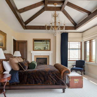 Elegant carpeted and white floor bedroom photo in Other with beige walls and a standard fireplace
