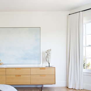 Inspiration for a large contemporary master light wood floor and beige floor bedroom remodel in San Francisco with beige walls