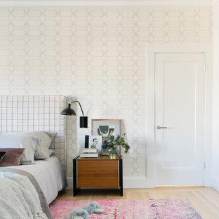 Example of a large trendy master light wood floor and beige floor bedroom design in San Francisco with beige walls