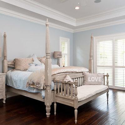 Bedroom - tropical bedroom idea in Miami with blue walls