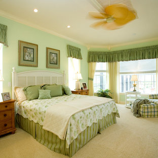 Elegant carpeted bedroom photo in Miami with green walls and no fireplace