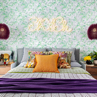 Inspiration for a mid-sized eclectic loft-style bedroom in Boston with multi-coloured walls and no fireplace.