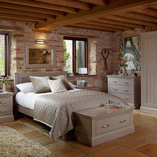 Modern bedroom with slate floors and brown floor.