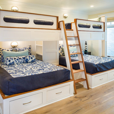 Inspiration for a large coastal guest light wood floor and beige floor bedroom remodel in San Diego with yellow walls and no fireplace