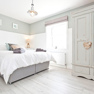 Photo of a mid-sized traditional bedroom in Dorset with grey walls and grey floor.