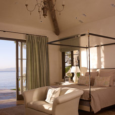 Mediterranean Bedroom by Tim Clarke Design
