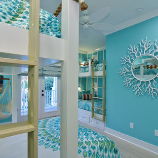 Inspiration for a mid-sized coastal guest light wood floor bedroom remodel in Tampa with blue walls