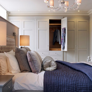 Transitional master bedroom in Gloucestershire with no fireplace.