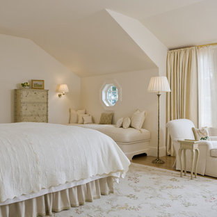 Inspiration for a timeless master light wood floor bedroom remodel in Boston with beige walls and no fireplace