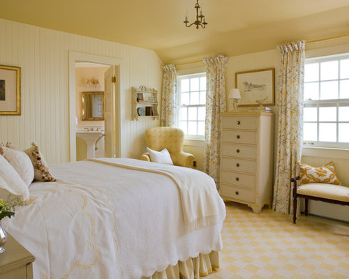 example of an ornate carpeted bedroom design in boston with yellow walls - Yellow Themed Bedroom