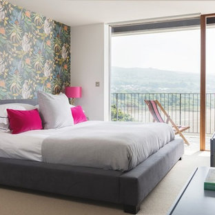 Design ideas for a medium sized contemporary bedroom in Other with white walls, carpet and beige floors.