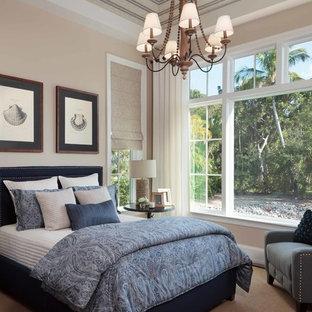 Large elegant master light wood floor bedroom photo in Miami with beige walls